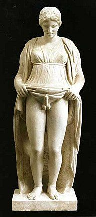 """This Hermaphroditus, called """"Stante"""" (relieved) is carved with the male member in erection, shown by the woman's dress lifted to the waist. Discovered in a vineyard of Monte Porzio Catone in 1781 and purchased by prince Marcantonio Borghese, it was long kept hidden in a closet because it was considered indecent. Roman marble, Imperial period (3rd century CE)"""