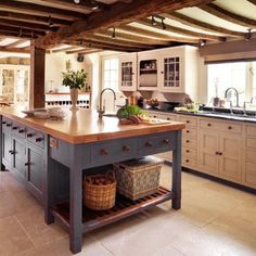 Love beams in the ceiling and the soapstone counters with white cabinets and then HUGE island...