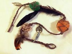 What in the World is a Witch's Ladder?: This witch's ladder includes sea glass, charms, and feathers.