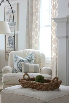 My curtains are so similar to these in my living room. Love! Great chair/ottoman with decorative pillows.