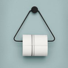 From danish design house Ferm Living - The black toilet paper holder is both beautiful and functional – the perfect accessory for any bathroom. The black stained oak and black metal give the toilet paper holder a timeless look.