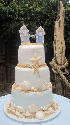 Our Beach themed sea shell cake with beach hut topper