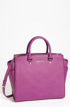 This stands on its own. Michael Kors Leather Tote.