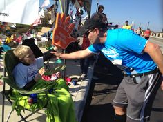 Awesome. @Nationwide Children's Hospital Patient Champion, Nicholas, high-fives a marathoner during the race.