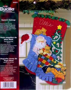 Bucilla ~ Santas Catnap ~ 18 Felt Christmas Stocking Kit complete with real lights.  This is a discontinued 2007 pattern so please make sure you dont miss the chance to purchase one while there are still new ones available.  Santa is all curled up in his striped pajamas with some of