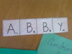 scrabble door decs...scrabble the apartment mates names together (but keep the names full, just overlap so they can come apart in the end)