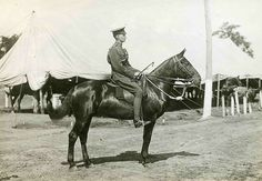 A photograph, mounted on card, of a Canadian soldier on horseback.