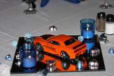 Lindsay: We included an element of my husband, Brad. He LOVES cars! Our centerpieces - 1/25 Scale cars with decals that read: Official Pace Car: Brad and Lyndsay's Wedding. We put the decals on ourselves. (Cute)