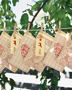 Bags for each guest hang from a clothesline. Inside each bag is a program and recipe book featuring, among others, the caterer's recipes.