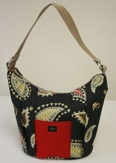 This Dakota Shoulder Bag in Curtsey Sundown body with Fabu-lust Cherry pocket was designed by Mary Kathy L. from Haverhill, MA.