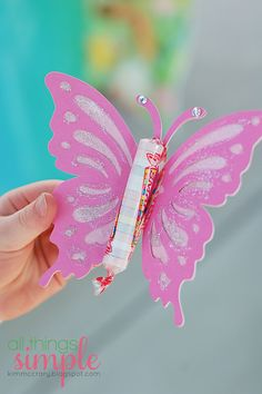 We had them add sparkly gems to the antennae and painted the wings with glitter glue. (Putting the glitter glue in 2 oz plastic cups with lids and using Q-tips to paint made clean-up a breeze.)