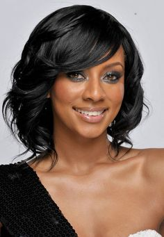 Keri-Hilson-Medium-Length-Black-Curly-Hairstyle