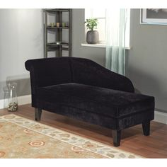 @Overstock.com - Milan Microfiber Black Storage Chaise Lounge - Sleek, modern lines, black hardwood legs and soft black microfiber upholstery highlight this Milan storage chaise. This lounge bench opens to reveal a unique hidden storage space under the seat.  http://www.overstock.com/Home-Garden/Milan-Microfiber-Black-Storage-Chaise-Lounge/7499765/product.html?CID=214117 $309.99