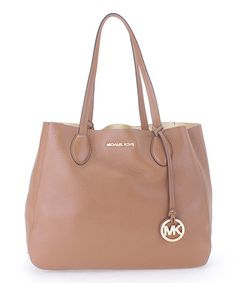 dab184a895da3 ... Perforated Leather Shoulder Bag. See more. Look at this  zulilyfind!  Acorn  amp  Pale Gold Mae Large Leather Tote