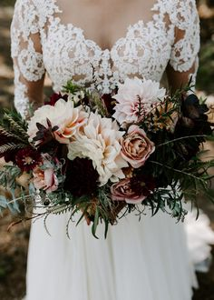 Enchanting overgrown bridal bouquet with rich greenery and soft pink blooms | Image by Vera Gayazov Photography