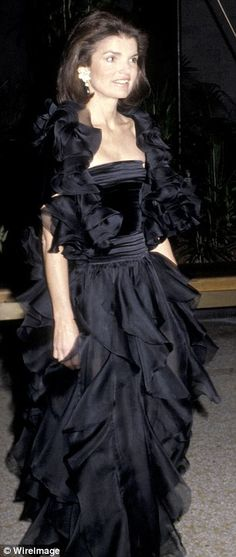 Jackie Kennedy Onassis wears a ruffled black gown in 1979.