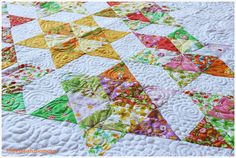 Cute idea for triangle quilt- Turn them into stars.