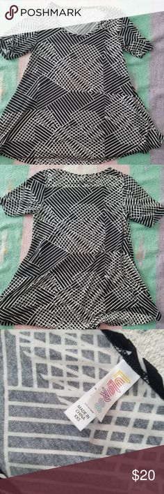 LuLaRoe Perfect T Black White Abstract Lines LuLaRoe   Women's size XXS  Perfect T  Gently used from a smoke free home  94% Polyester, 4% Spandex LuLaRoe Tops Tees - Short Sleeve