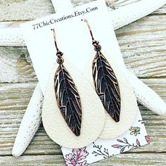 Soft ivory leather paired with copper leaves and artisan ear wires.