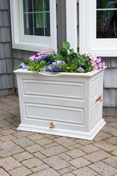 <ul><li>SKU SV-ERS.</li><li>50 gallon capacity rain barrel w/ 1 cubic foot planter top.<li>Colonial style.<li>Flat back design sits tightly against any outside wall.<li>Routed channel diverts excess water to the front of the barrel.<li>Dual spigot locations for hose or five gallon bucket.<li>Brass spigot features leak proof seal.<li>Mesh screen to filter out debris and deter pests.<li$159.99