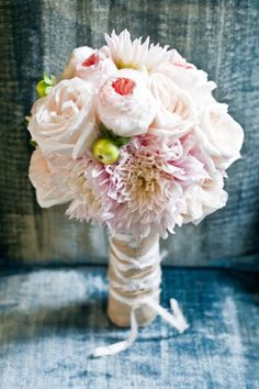Blush Pink Bridal Bouquet. Blush Dahlias and buds, Pink Ranunculus, White O'Hara Alexandra Farms Garden Roses and Peach Juliet David Austin Garden Roses wrapped in Burlap.