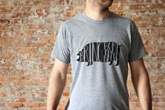 Bring Home The Bacon Featured against the dark silhouette of a pig, this unique typographic design was hand-lettered with love and screen printed by hand. All artwork is original and printed on a high-quality, super soft American Apparel tee. Photographed in black ink on a heather gray crew neck shirt. A tri-blend of 50% polyester - 25% ring-spun combed cotton - 25% rayon. Available as crew neck, as pictured, or v-neck. ____________________ SIZE CHART for MENS TEE SIZES (in inches): • XS…