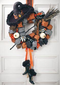 Halloween wreath.  Love the painted pumpkins & broom.  www.Grandinroad.com