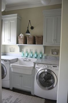 I like the organization and the cupboards and the wicker baskets. This would be a sweet idea for a laundry and staff area