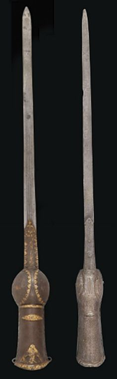 TWO ELEPHANT GAUNTLET SWORDS (PATAS)   INDIA, 18TH CENTURY   Of typical form, one with fine gold floral damascening and blade marked with pairs of moon crescents