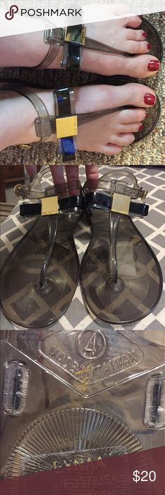 Ted Baker Jelly Sandals with bow size 6 New with sticker tag! Ted Baker Black jelly style sandals. Has a cute bow with gold metal detail and TED BAKER name on it. Ted Baker Shoes Sandals
