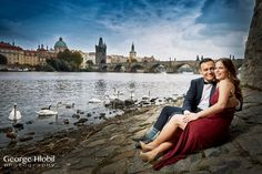 Engagement photography in Prague - Portrait photo session for couples - Vacation photos in Prague, more engagement pictures from Prague at www.georgehlobil.com #couplephotography #honeymooninprague #vacationphotos #engagement #photoshoot #couple #photosession #destination #honeymoon #charlesbridge #riverviews #swans