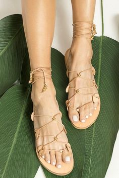 Our signature Danae gladiator sandals are inspired from the ancient Greek wave motif as it also appears in our logo. This pair is made from chemical-free vegetable-tanned leather with adjustable slim ties that can be worn high up or low at your ankles, detailed with gold plated beads and coins. Top quality lace up sandals with anti-slip rubber sole for optimum comfort suitable for everyday wear from day to night and the neutral shade will complement just about everything. Available in 5… Tie Up Sandals, Boho Sandals, Leather Gladiator Sandals, Greek Sandals, Flat Sandals, Summer Shoes, Summer Outfit, Ancient Greek, Leather And Lace