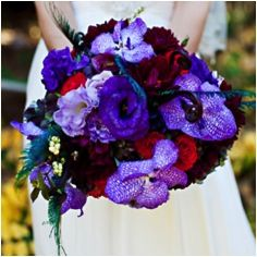 royal purple + red wedding - add in some softer fuchsia pink highlights and would be very dramatic