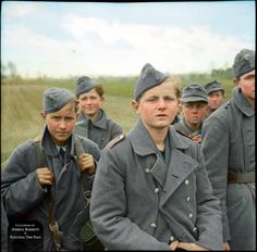 A group of young German prisoners, members of a Luftwaffe anti-air squad (Flakhelfer), captured by the advancing British Armoured Division in the village of Levern, Germany. German Boys, German Men, German Army, Luftwaffe, Man Of War, Total War, Prisoners Of War, History Photos, Historical Pictures
