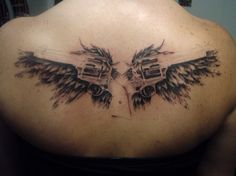 gun-tattoos-designs-angel-wings-with-guns-tattoos-on-back-27.jpg (800×597)