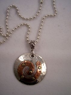 Riveted sterling & copper swirl pendant necklace by KathrynKatz