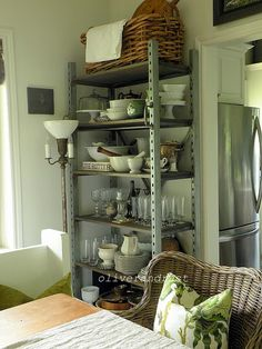 Industrial Shelving in an eclectic vintage dining room