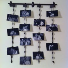 Fun photo hanger I saw this in a home decor magazine so I made it myself!  I wasn't able to find any of the picture clips so I asked the manager at Lowes if I could buy their end cap product clips. $2 a piece! Lol They were grey do I spray painted them! The top bar is a curtain rod.