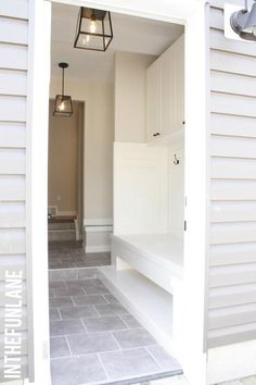 The whole thing - barnlight, pendants, built ins Mudroom entrance. Love the stone floor, color scheme and built in bench. Vestibule, Home Interior, Interior Design, Mudroom Laundry Room, Entry Hall, The Ranch, Built Ins, My Dream Home, Dream Homes