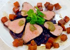 Get Emeril Lagasse's Jerk-Spiced Pork Tenderloin with Black Beans and Caramelized Sweet Potatoes Recipe from Cooking Channel