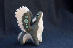 http://hontor.deviantart.com/art/Little-winged-wolf-plush-478259738