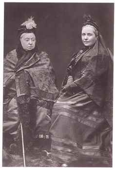 Queen Victoria and her daughter Vicky, Queen of Prussia.  They are wearing mourning clothes.  Victorians spend much of their time in mourning for assorted relatives.