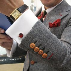 Grey men suit and red cufflink combination