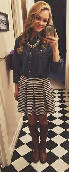 Denim shirt + navy and white stripe pleated skirt + brown leather boots + statement necklace