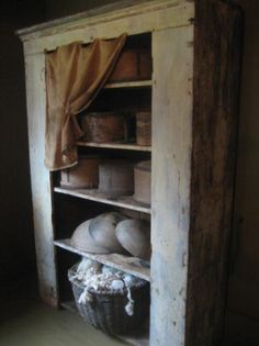 lovely prim cupboard with dry measures, wooden bowls and basket