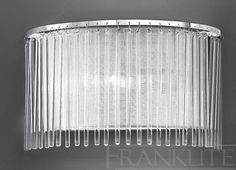 The Eros Wall Light by Franklite Lighting is available from Luxury Lighting - approved Franklite Retailers. The Franklite Eros wall light is in a chrome finish with a lurex fabric shade surrounded by delicate glass rods.