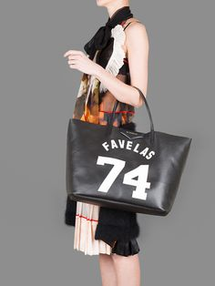 GIVENCHY 74 FAVELAS LARGE TOTE WITH METAL LOGO AND COTTON CANVAS LINING WITH POUCHES INSIDE HEIGHT: 55CM WIDTH: 33CM DEPTH: 19CM