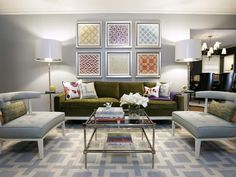 The gray walls, chairs and rug bring a soothing touch to this otherwise playful living room.