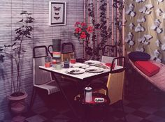 1957 Almost 60s-like, woven textures bring an exotic element to this casual dining area.