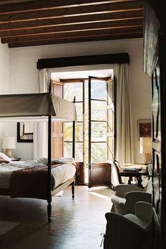 tall ceilings, exposed beams, french doors....
